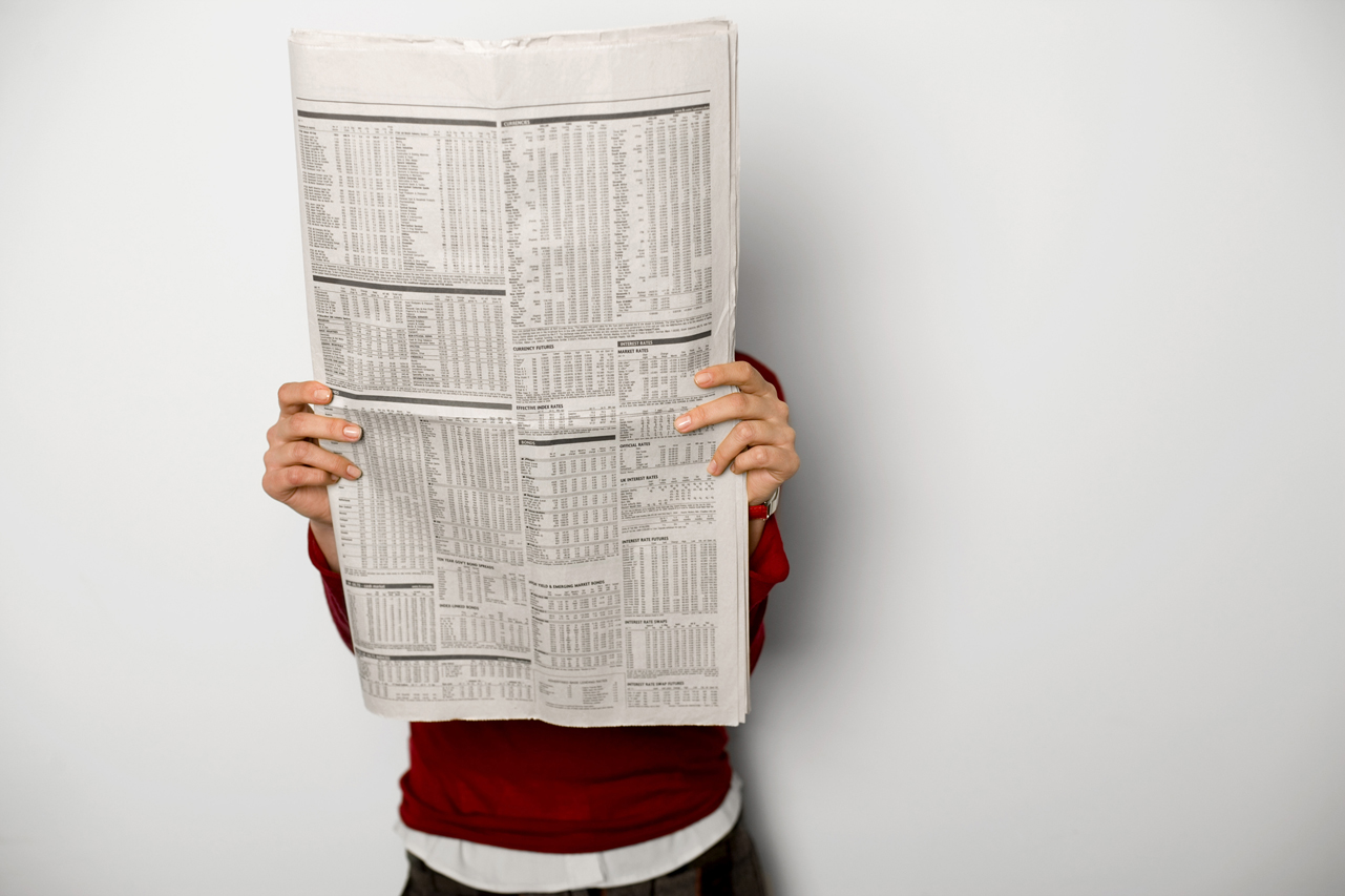 man holding newspaper
